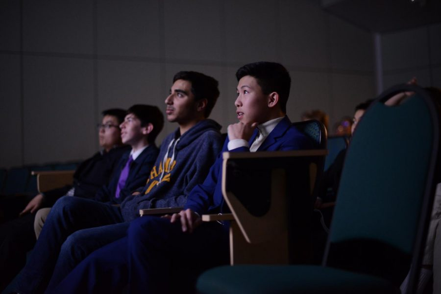 Student producer and director Ethan Choi (10) watches the premiere of his third movie,