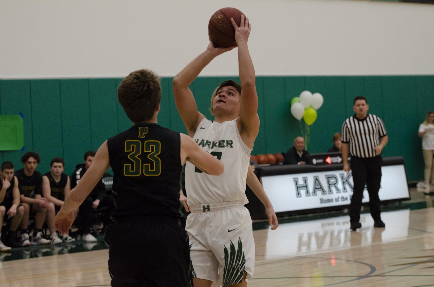 Trevor Thompson (12) attempts to score in the paint.  The varsity boys basketball team beat Pinewood 77-50 during their senior night game on Feb. 12, ending the regular season with a league record of 6-8.