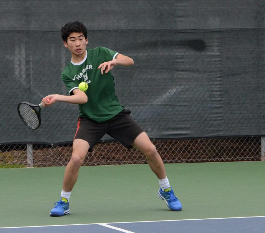 Richard Hu (11) hits the ball during the match last Monday against Nueva. The boys play tomorrow at Sacred Heart.