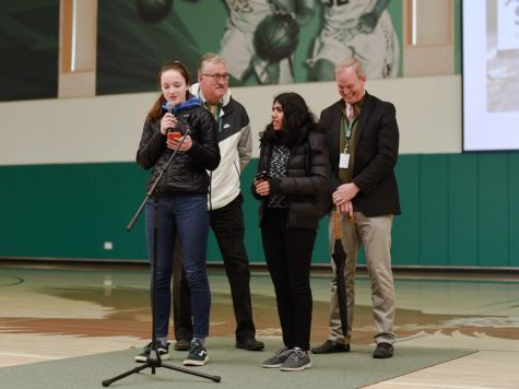 Members of Green Team Ashley Jazbec (11) and Anvi Banga (11), joined by Head of School Brian Yager and Upper School Head Butch Keller, announce that the cafeteria will no longer provide single-use plastic as a part of an initiative for environmental sustainability.