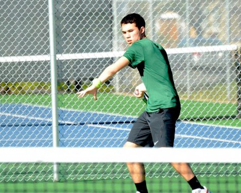 Kai Franz (12) returns the ball during the match against Kings on Monday. Their overall record now stands at 4-1.