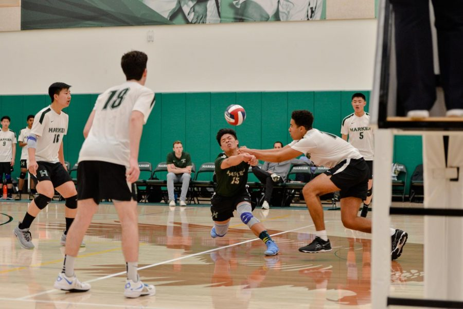 Brian Pinkston (10) and Chris Gong (12) reach to spike the ball at the same time during Friday's game against Monta Vista.