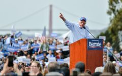 Sen. Bernie Sanders rallies supporters of his 2020 presidential bid at Great Meadow Park, gesturing at a podium against a backdrop of the Golden Gate Bridge in San Francisco. Sanders completed his California tour this afternoon, after making stops at San Diego and Los Angeles in the past weekend.