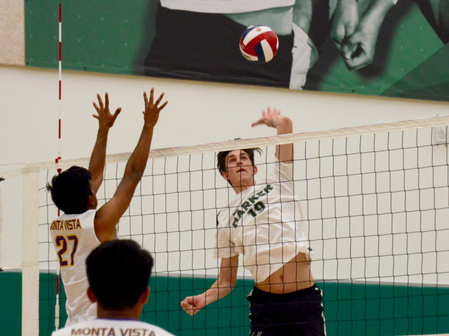 Senior Jared Anderson jumps to hit the ball during the varsity volleyball team's game against rival Monta Vista High School on Friday.
