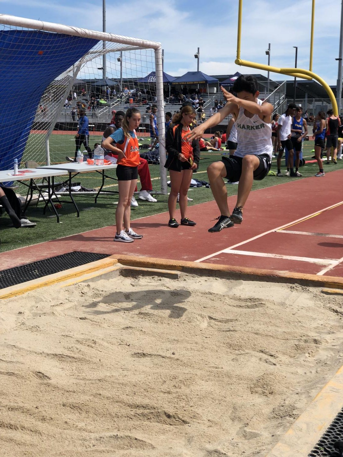 Andrew+Chen+%289%29+jumps+into+the+long+jump+pit+during+the+Bearcat+Invitational+at+San+Mateo+High+School.+Andrew+jumped+17+feet+6+inches%2C+tying+a+personal+best.+