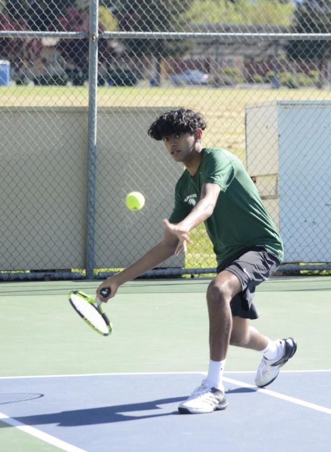 Gowtham+Irrinki+%2810%29+plays+in+a+varsity+match+on+Wednesday.+The+team+won+4-3+against+Pinewood.+