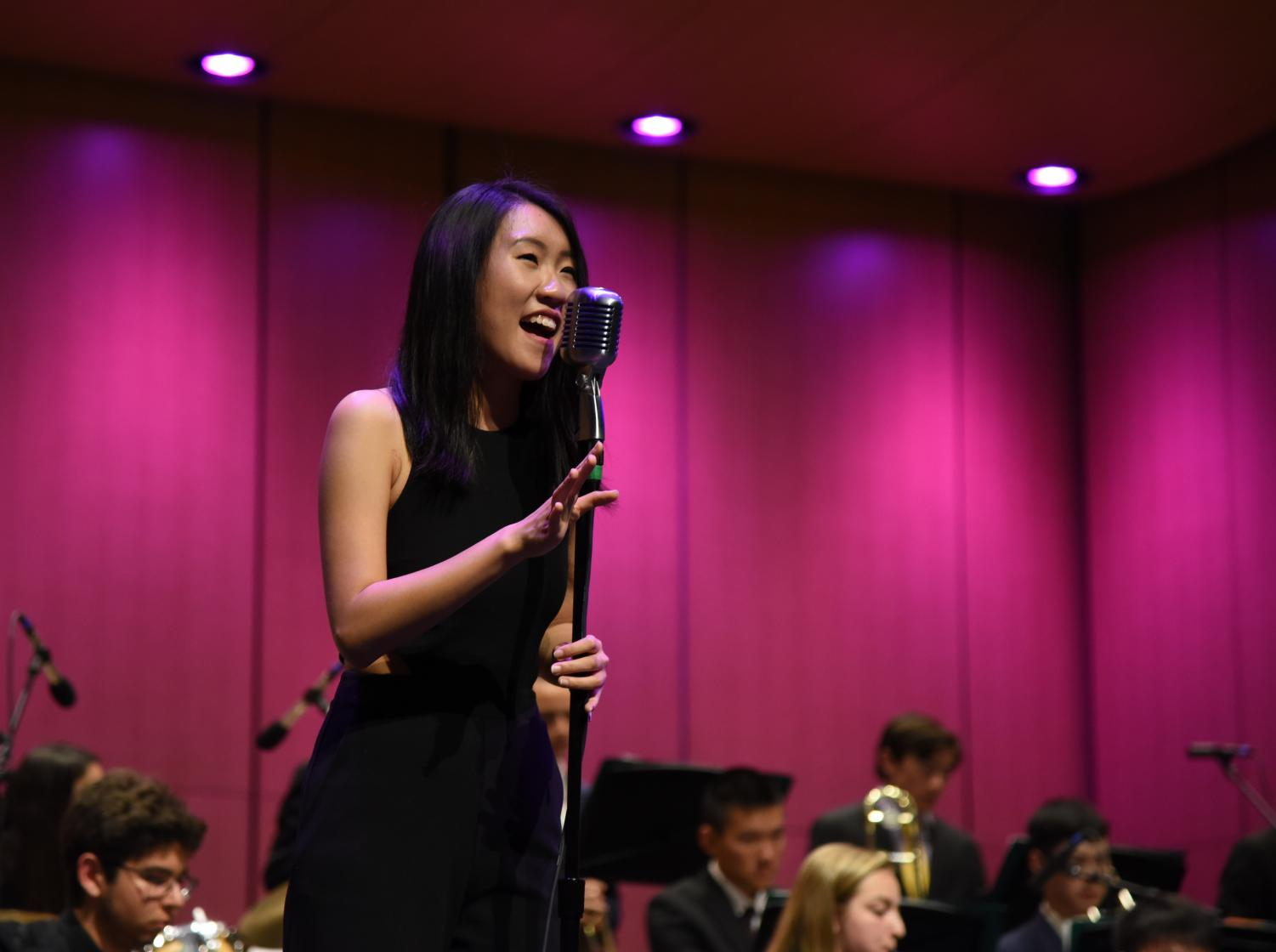 Kelsey Wu (12) sings with accompaniment from the upper school's Jazz Band. Kelsey was among the seniors honored at the end of her performance.