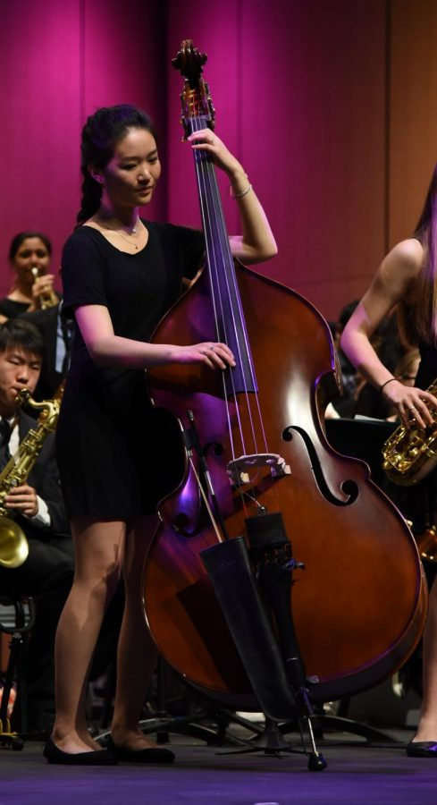 Connie Xu (12) plays the upright bass as a member of the upper school's Jazz Band. Connie was one of the seniors honored at the end of the night.