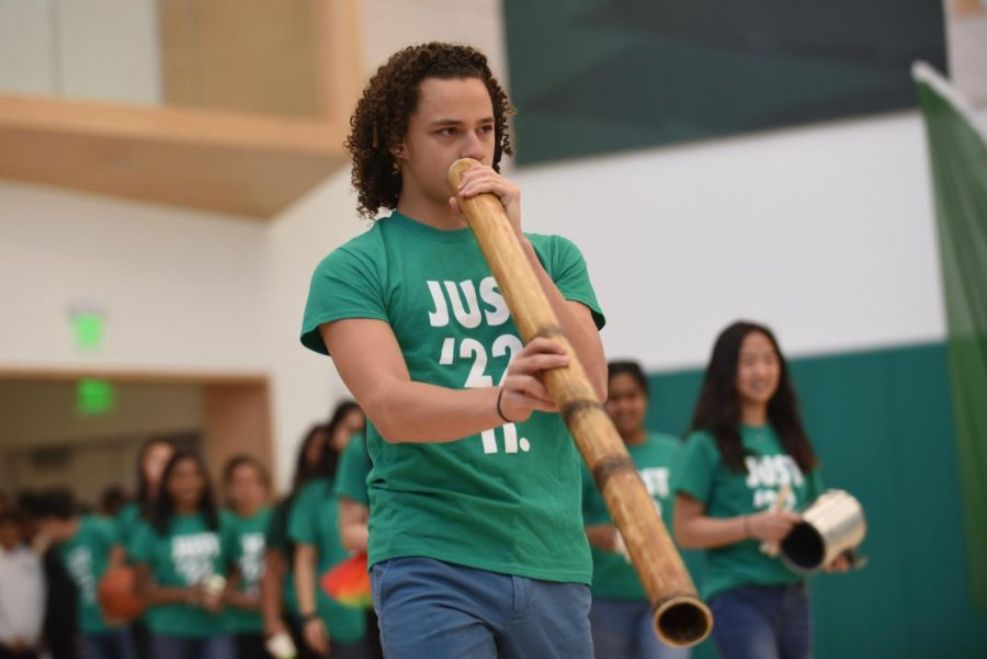 Kai+Burich+%289%29+opens+the+freshman+class+Roar%2C+marching+into+the+gym+while+playing+a+large+wind+instrument.+The+freshman+class+placed+fourth+in+the+Roar+event%2C+behind+the+juniors%2C+who+placed+third%2C+the+sophomores%2C+who+placed+second%2C+and+the+seniors%2C+who+placed+first.+
