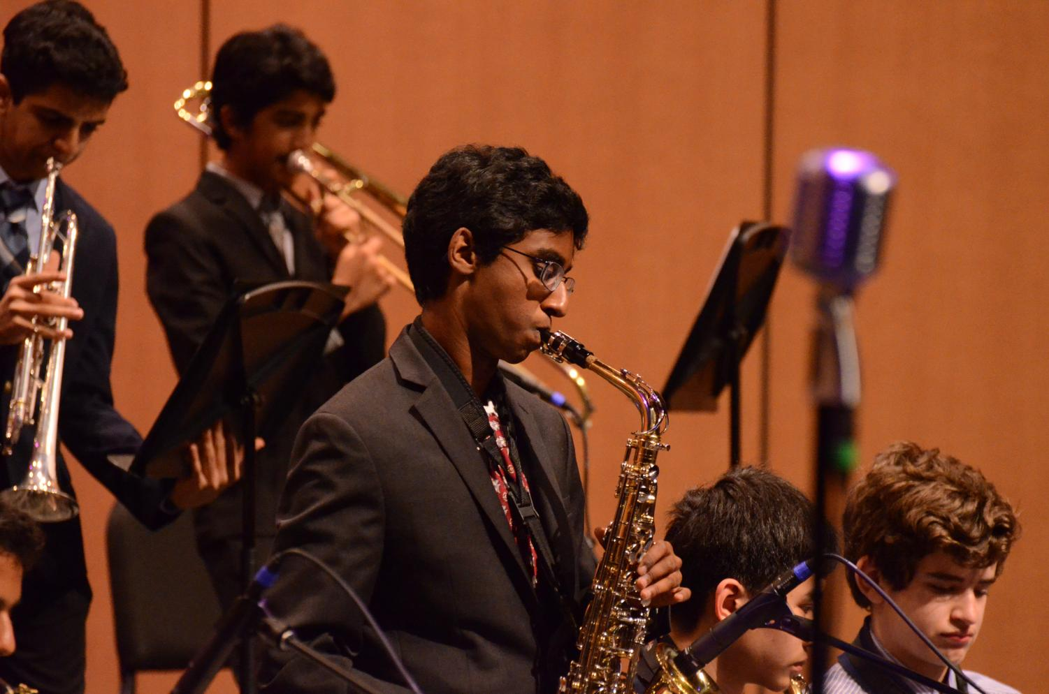A saxophonist solos on top of the upper school Jazz Band's set during Evening of Jazz. Both upper schoolers and middle schoolers performed at the event, which featured an extensive set list as well as a ceremony honoring the graduating seniors.