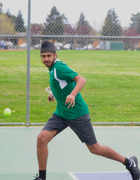 Junior Simar Bajaj focuses on the ball as he prepares to hit it during his doubles match on Monday. The team next plays against Menlo on Monday, April 15.