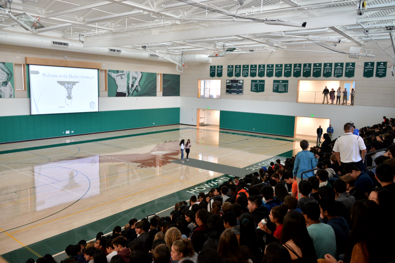 The student body and faculty gather in the Athletic Center to watch the documentary