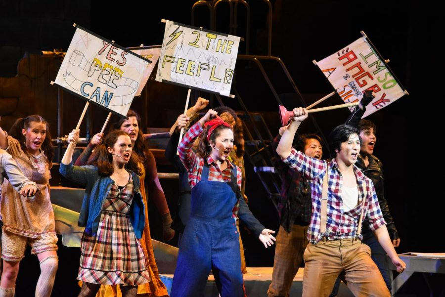 Bobby+Strong%2C+played+by+Mathew+Mammen+%2812%29%2C+leads+a+team+of+rebels+in+the+first+act%27s+finale+number+in+the+musical+%22Urinetown.%22+The+cast+performed+four+shows+from+March+28+to+March+30+in+the+Patil+Theater.