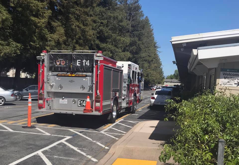 A firetruck parked in the back loading zone in response to a 911 emergency call. The firetruck and accompanying ambulance left shortly after 3:30 p.m.