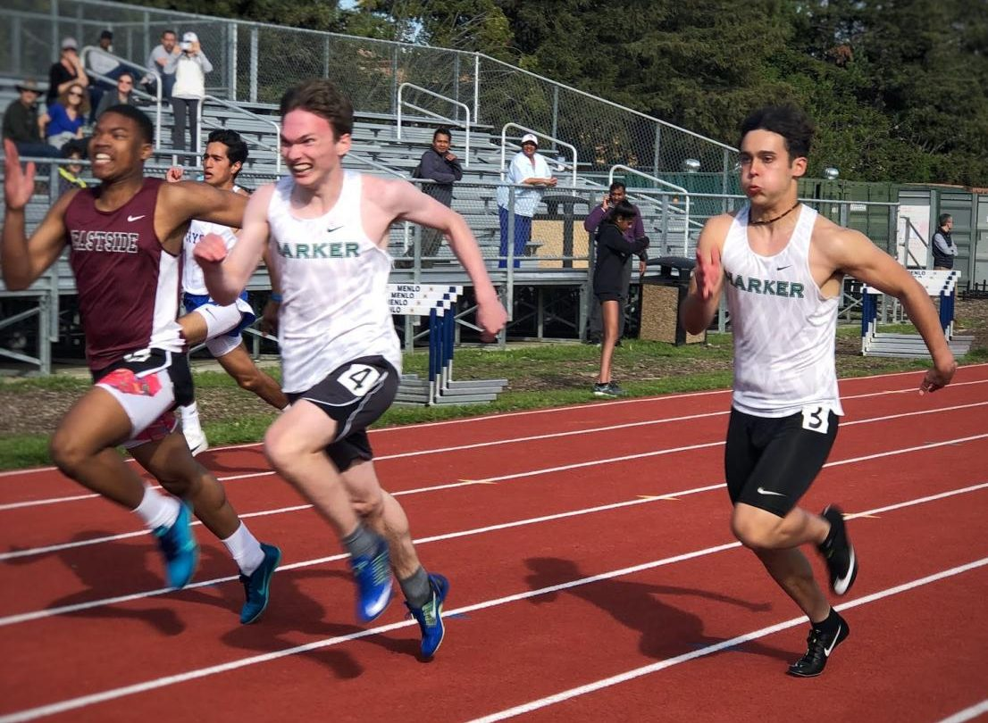 Anton Novikov (10) and Mitchell Granados (12) run in the first heat of the boys 100m dash finals. Anton won the race, with Mitchell coming in third.