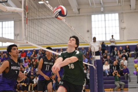 Charlie Molin (12) saves a ball near the net during the third set, which the Eagles won 25-19 to give them a 2-1 lead in the match.