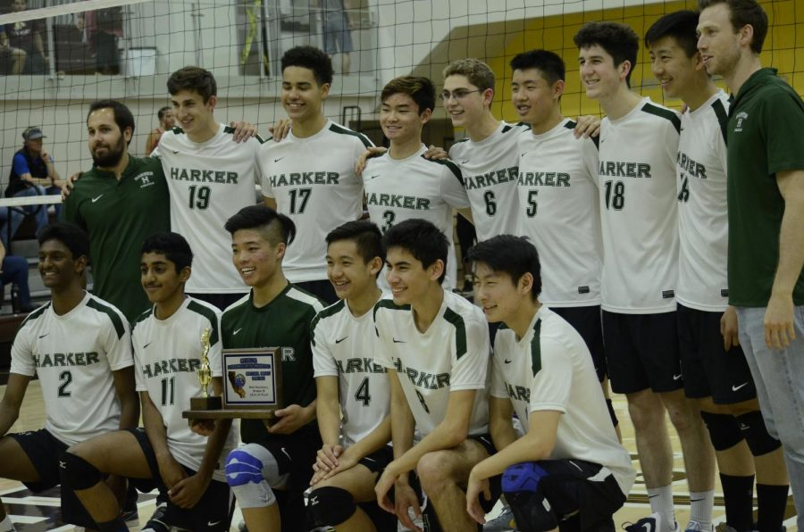 The+volleyball+team+poses+with+their+first+place+CCS+trophy+following+the+match.+The+Eagles+won+in+three+sets.+