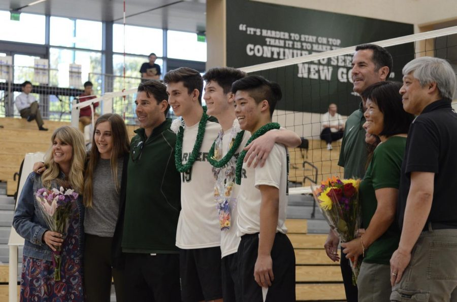Seniors Jarett Anderson, Charlie Molin and Chris Gong pose with family during the ceremony.