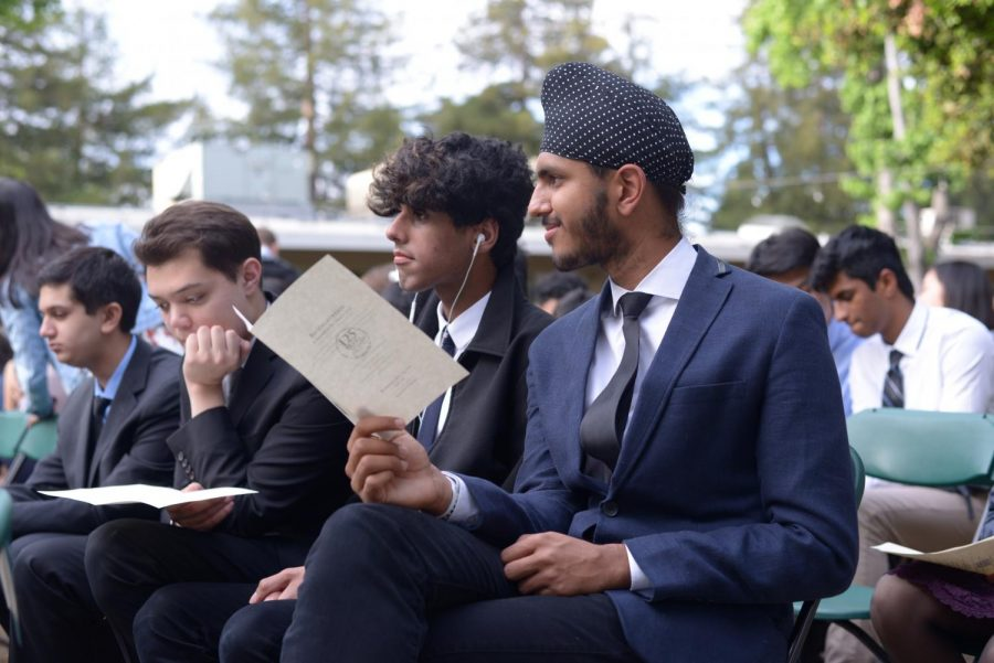 Juniors Simar Bajaj and Jai Bahri read the program, waiting for the ceremony to begin. At Baccalaureate, the school welcomes the rising seniors to be the future leaders on campus next year.