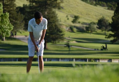 Varsity team captain Bryan Zhang (10) putts the ball during the league championship decider against Menlo on April 25. Bryan received his first career medalist honors, shooting a personal best of one under par.
