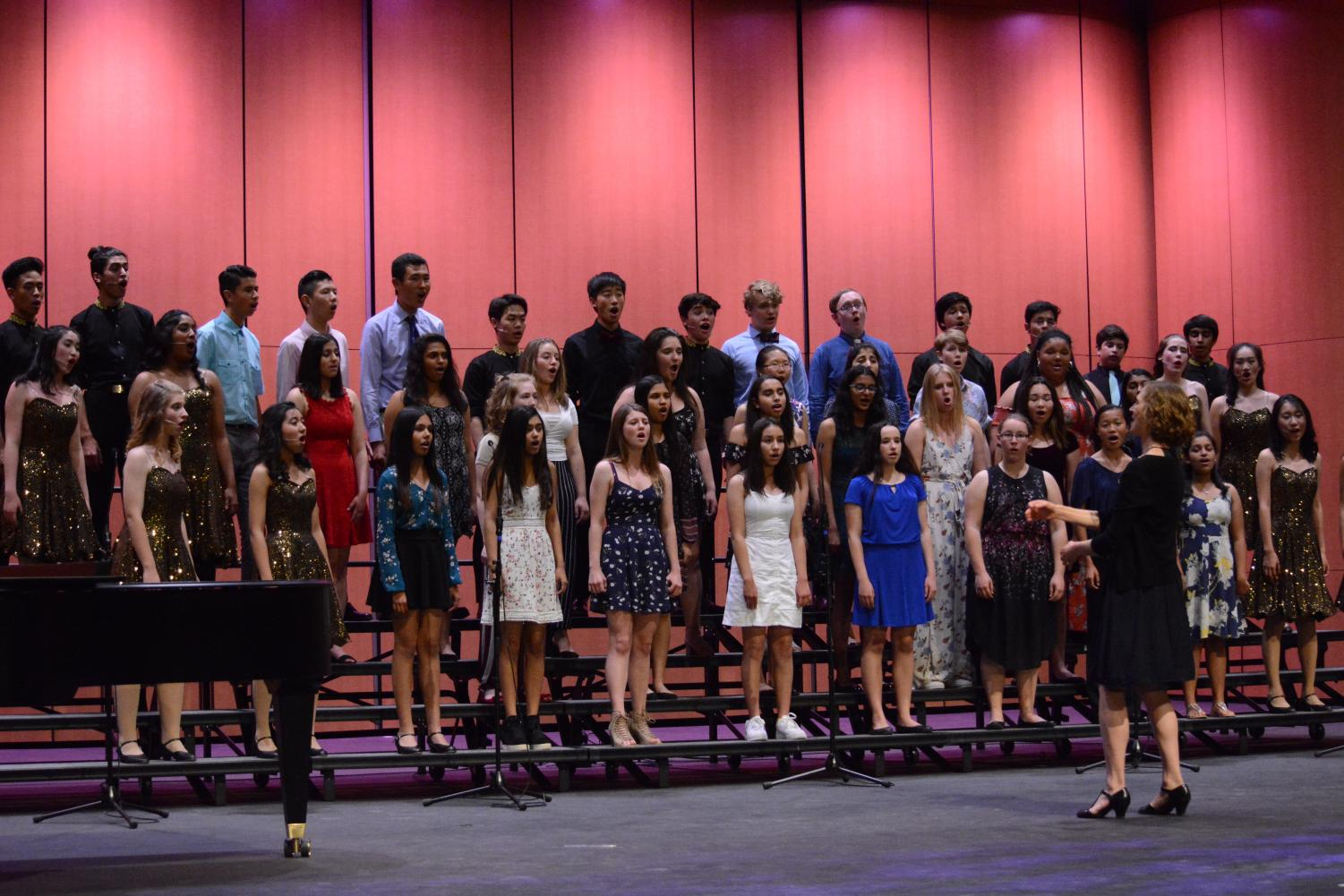 All upper school choral performers finished last Friday's concert with a closing song, Carly Simon's