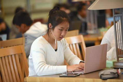 Audrey Liu (10) focuses concentratedly on her work in the library during AP week. AP Exams were help in both the Auxiliary Gym and Nichols Atrium.