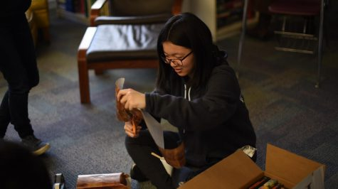 Meilin Yen (10) cuts some wrapping paper.