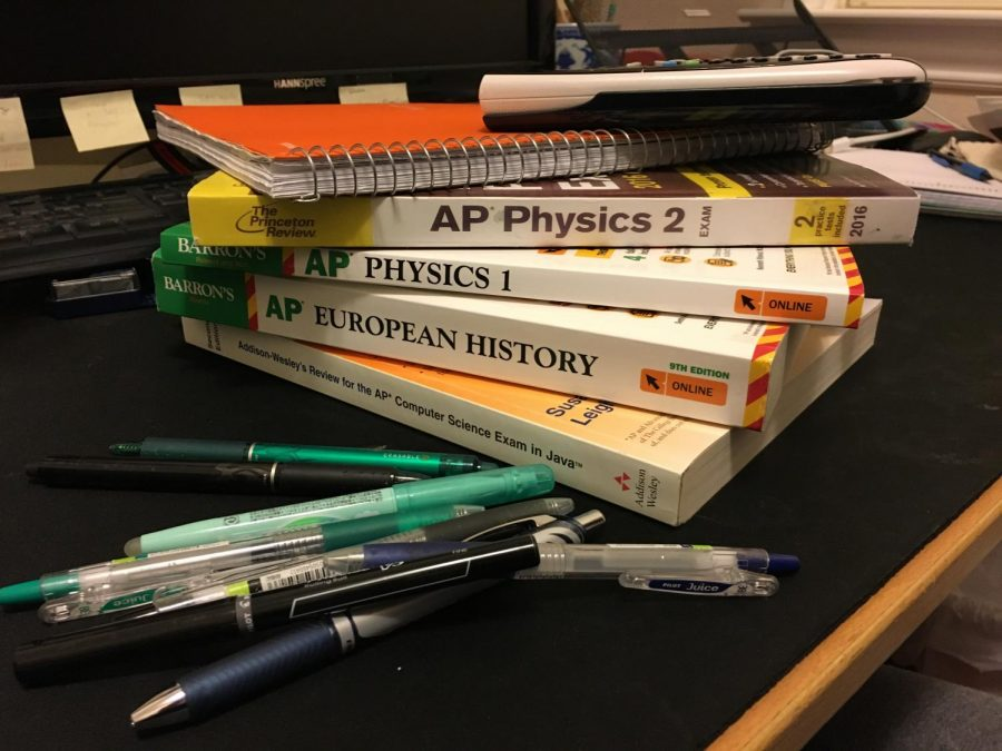 A+stack+of+AP+prep+books.+While+students+across+all+grades+are+busy+reviewing+for+APs+and+other+end-of-the-year+cumulative+exams%2C+Director+of+Standardized+Testing+and+Scheduling+Troy+Thiele+works+behind+the+scenes+to+coordinate+and+coordinate+testing+logistics.