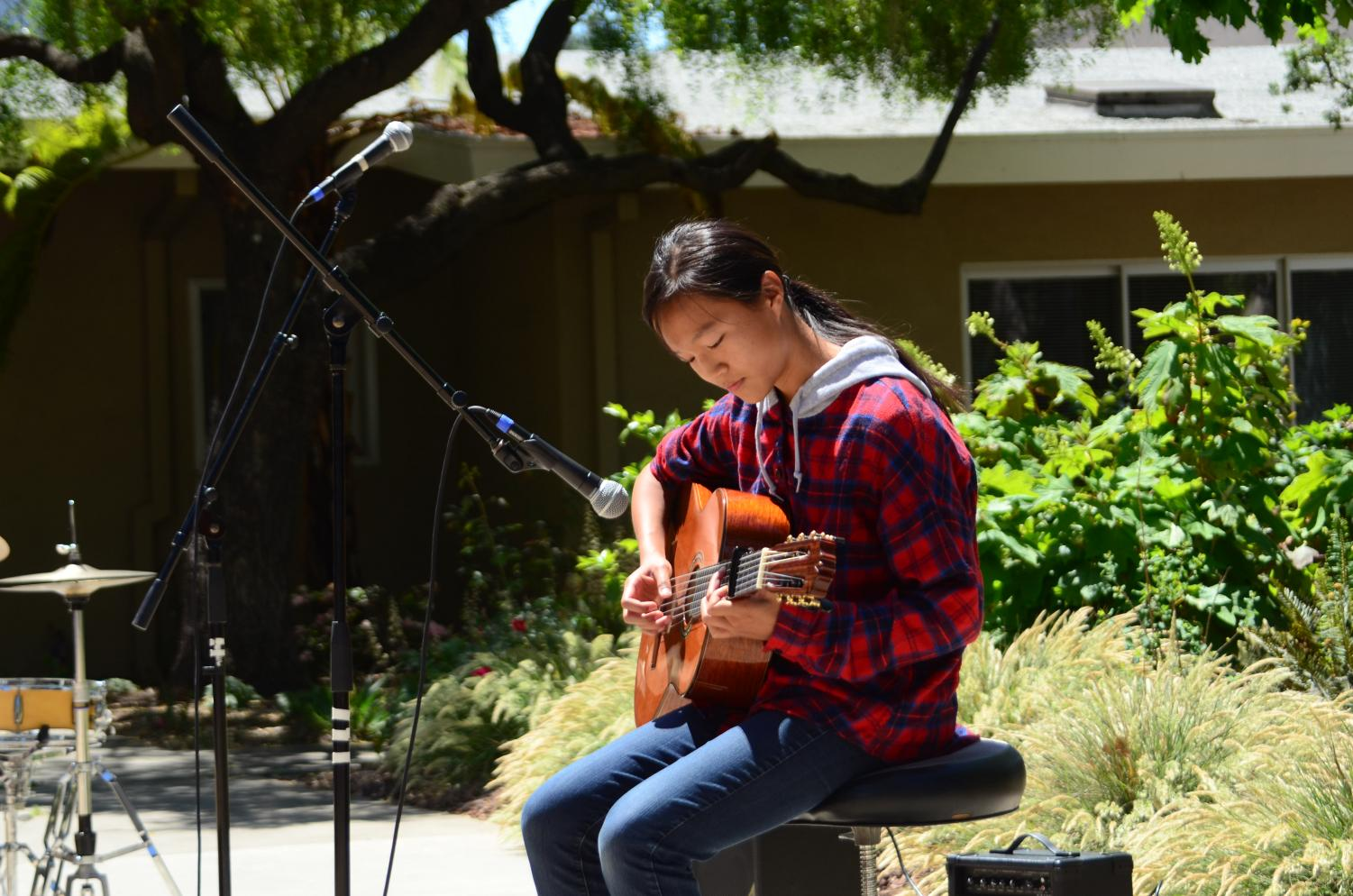 Teresa Cai (9) plays the guitar during the annual Quadchella. Both students and faculty performed at the event.