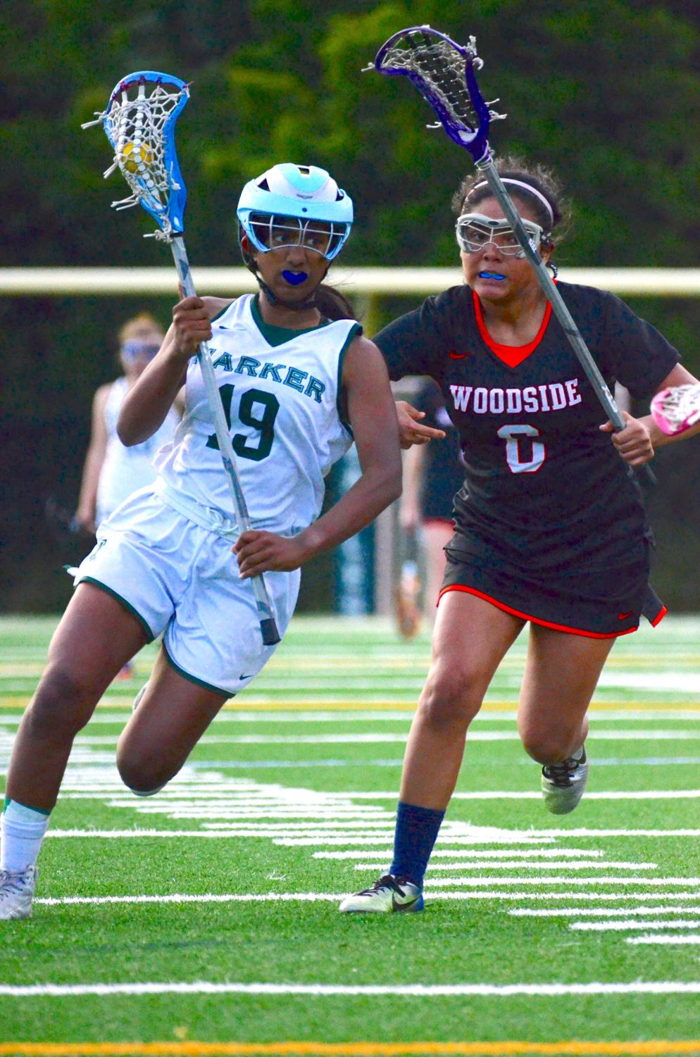 Anna Vazhaeparambil (10) cradles the ball as she runs past a defender, aiming for the opponents' goal in the semifinals. The girls lost 9-6 to Woodside.