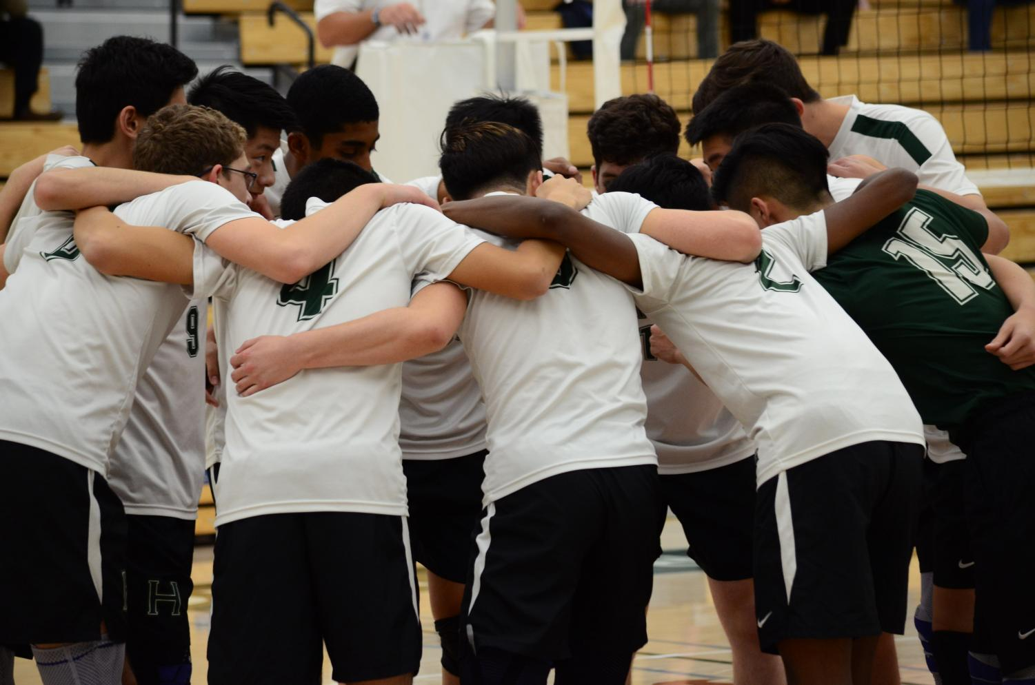 The boys team huddles up ahead of their NorCal quarterfinal game against Carmel, which they won 25-20, 26-24, 25-13.