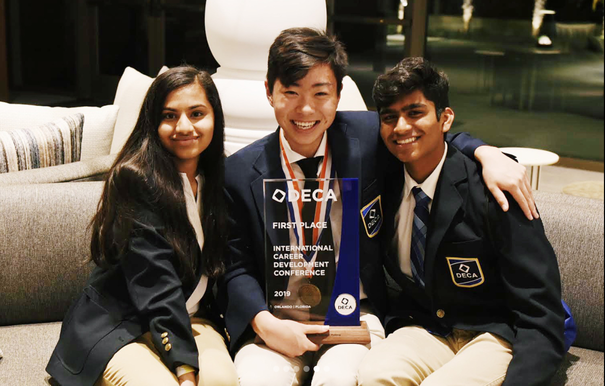 Juniors Mahi Kolla, Phil Han and Sid Dudyala pose with awards after the conference. The conference took place at Orlando, Florida.
