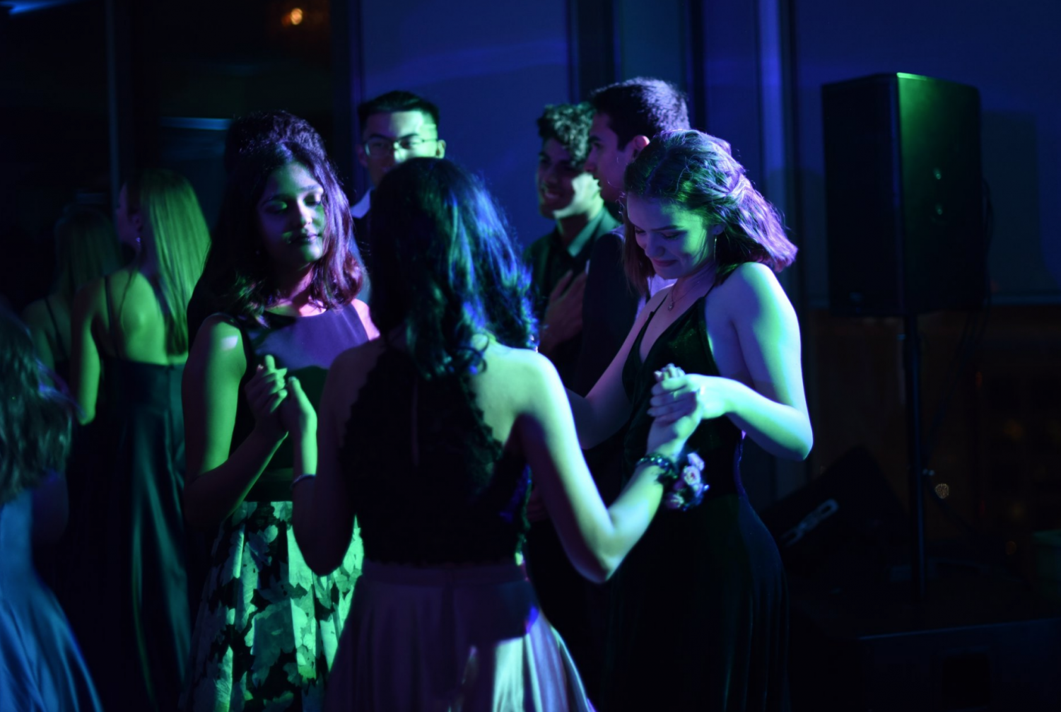 Junior Delaney Logue dances with friends at prom on Saturday. Prom was held at the Silicon Valley Capitol Club in downtown San Jose.