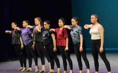 Members of both JV and Varsity dance stand in a line and execute a move from Olivia Esparza's (12) senior showcase dance.