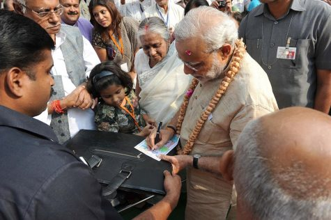 Prime Minister signs an autograph for a supporter following his victory last Thursday. Modi secured a landslide victory over his opponents, securing his second term in office.