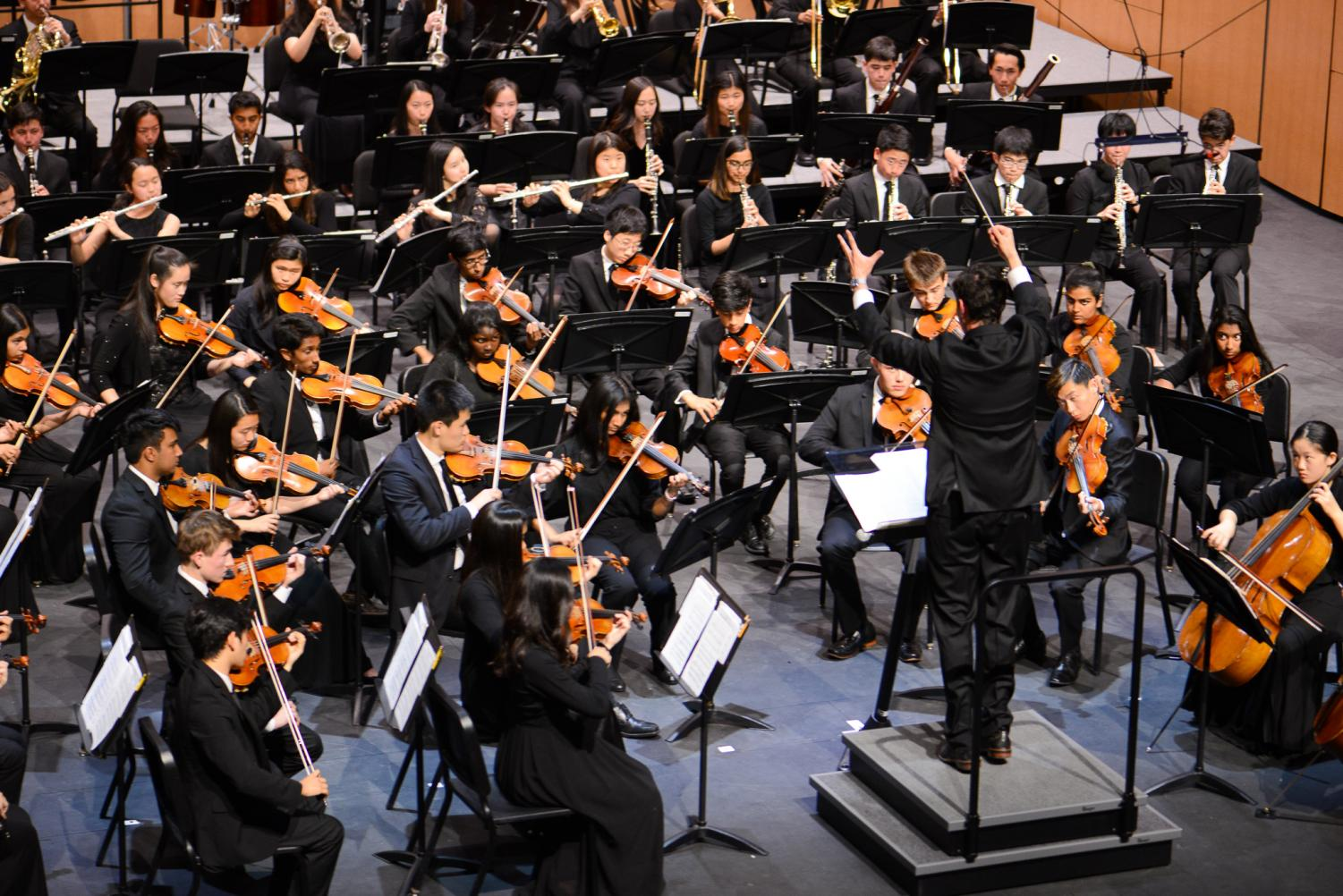 Conductor Dr. David Hart leads the upper school orchestra in a performance of Stravinsky's
