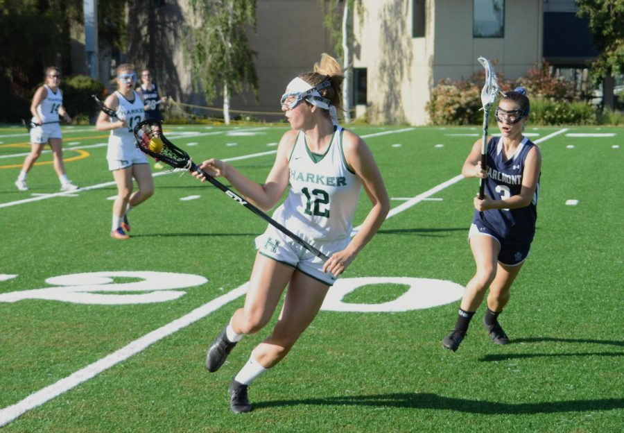 Julia Amick (12) receives a pass during a girls lacrosse game against Carlmont on April 26. The girls won the WBAL quarterfinals on May 7 with a score of 7-6.