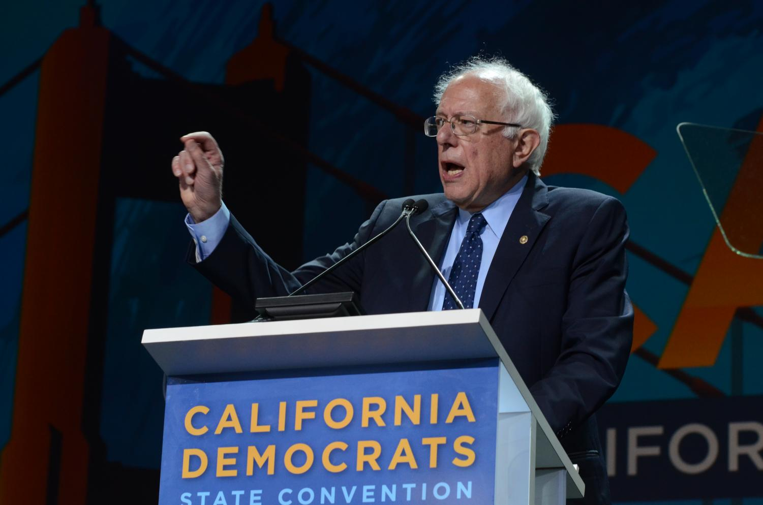 Presidential Hopeful Bernie Sanders raises concerns about economic injustices. He pledged to combat large corporations if elected president.
