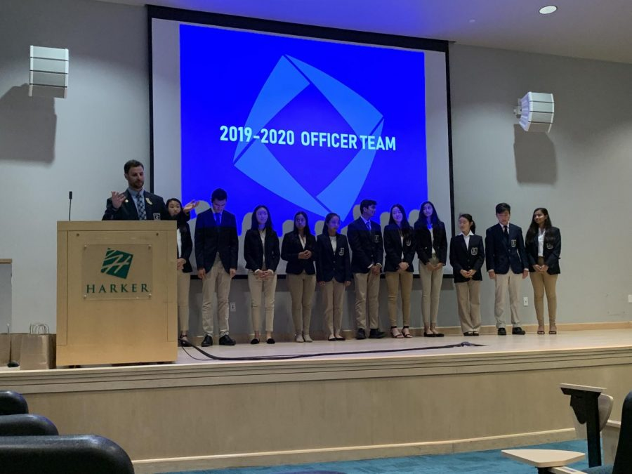 Glass presents the new officer team, lined up onstage in the Nichols auditorium. The 2019-2020 officer team consisted of 12 members.