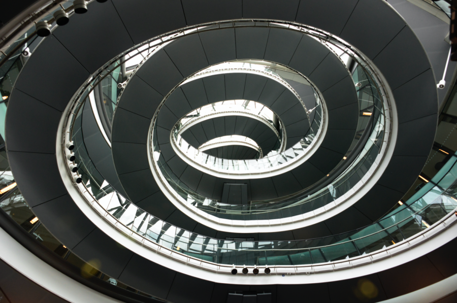 A staircase spirals up the north face of the city hall building. Constructed in 2002, the City Hall has a unique round shape on the outside and contains 7300 square meters of glass to provide natural lighting to the interior.