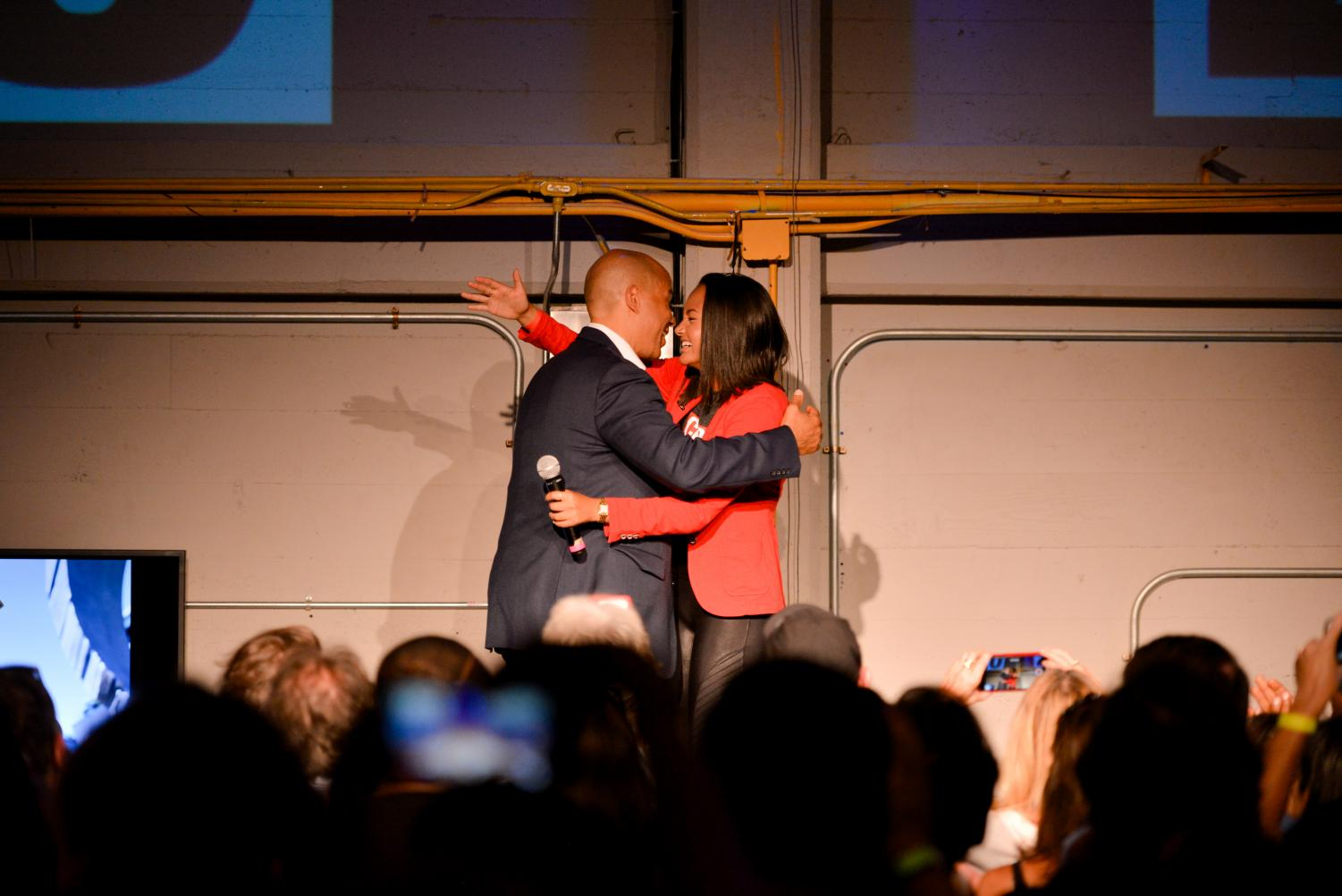 Democratic+presidential+hopeful+Sen.+Cory+Booker+hugs+supporter+Sydney+Brown%2C+a+college+freshman+from+Mill+Valley%2C+after+Browns+introductory+speech.+Brown+and+Booker+addressed+a+crowd+of+over+400+at+Bookers+happy+hour+fundraising+event+yesterday.