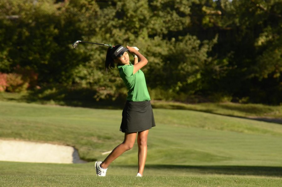 Olivia Guo (11) watches on after hitting the ball in the varsity girls golf team's match against Sacred Heart Prep.