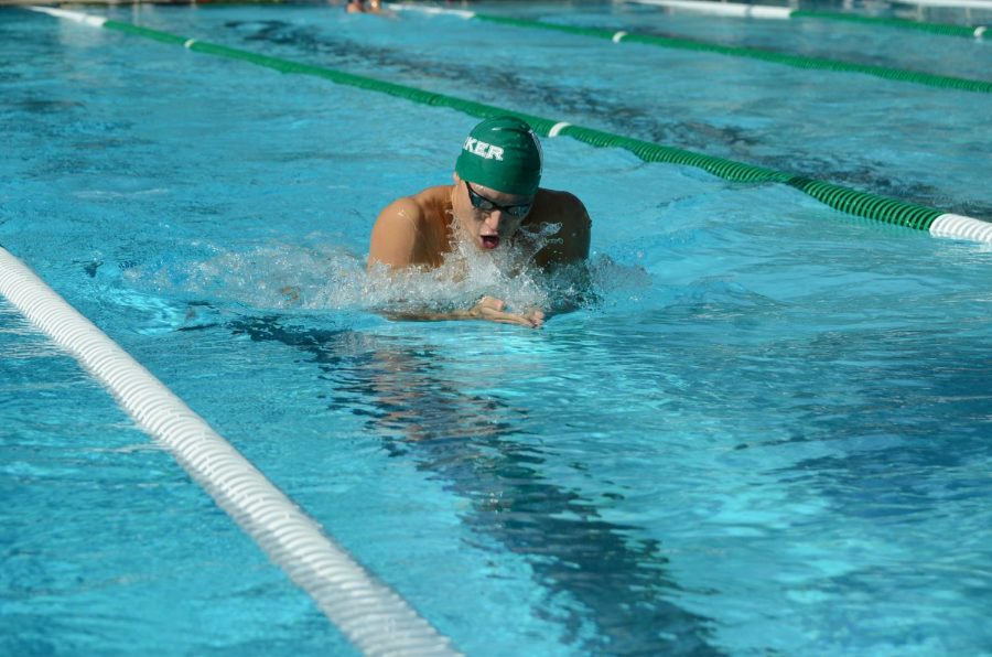 Ethan Hu (12) swims in the 200 IM against two opponents from King's Academy during a meet in the season.
