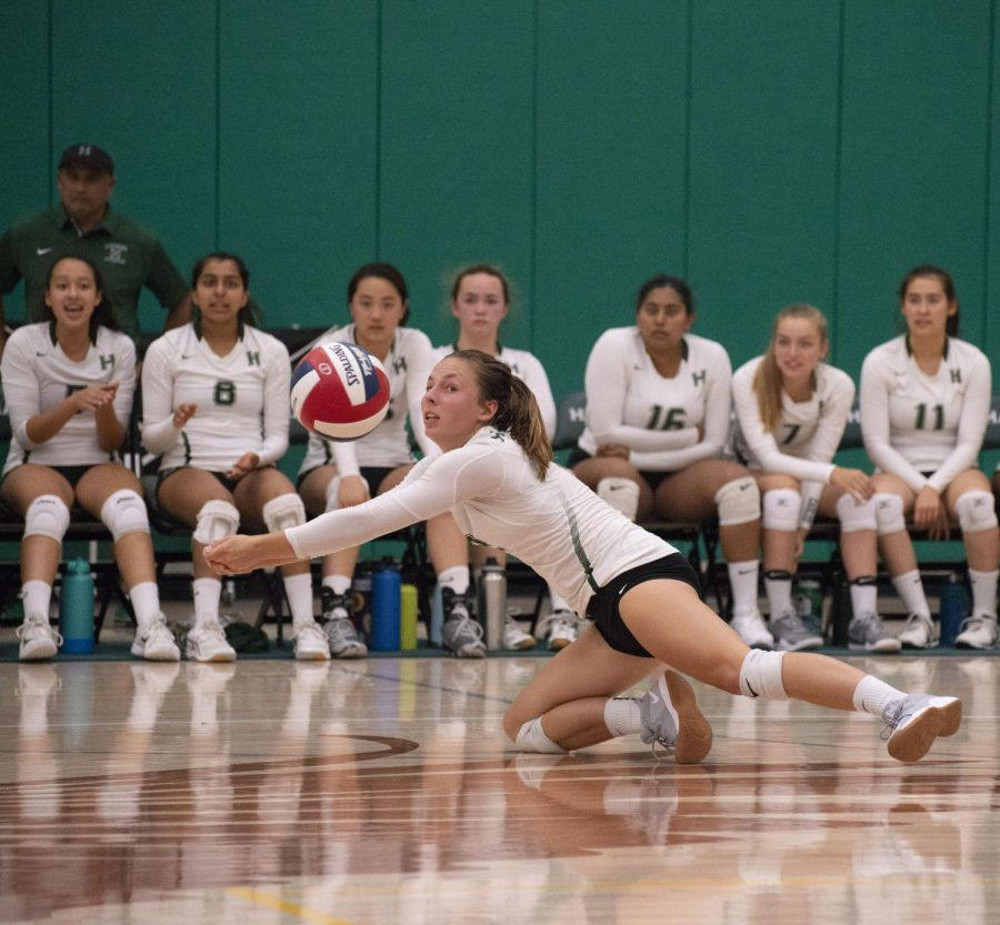 Anya Gert (12) dives to save the ball in the varsity girls volleyball team's match 3-1 win against Westmont High School.