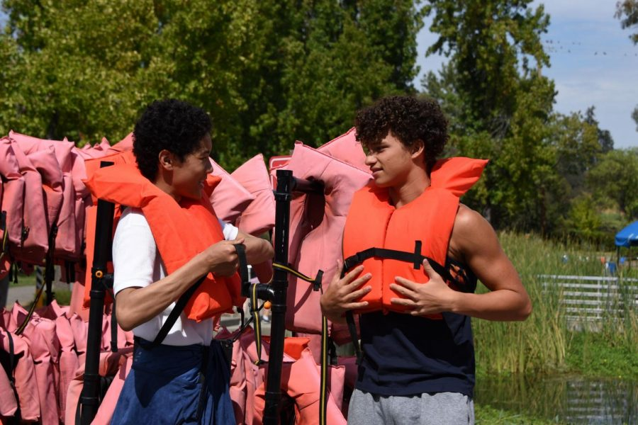 Kai+Due+%2810%29+and+Kai+Burich+%2810%29+put+on+their+lifejackets+before+going+out+on+the+water.+%E2%80%9CThere+was+a+lot+of+class+bonding.+I+feel+like+I%E2%80%99ve+become+a+better+member+of+my+class+and+have+contributed+to+the+Harker+community%2C%E2%80%9D+Kai+Due+said.