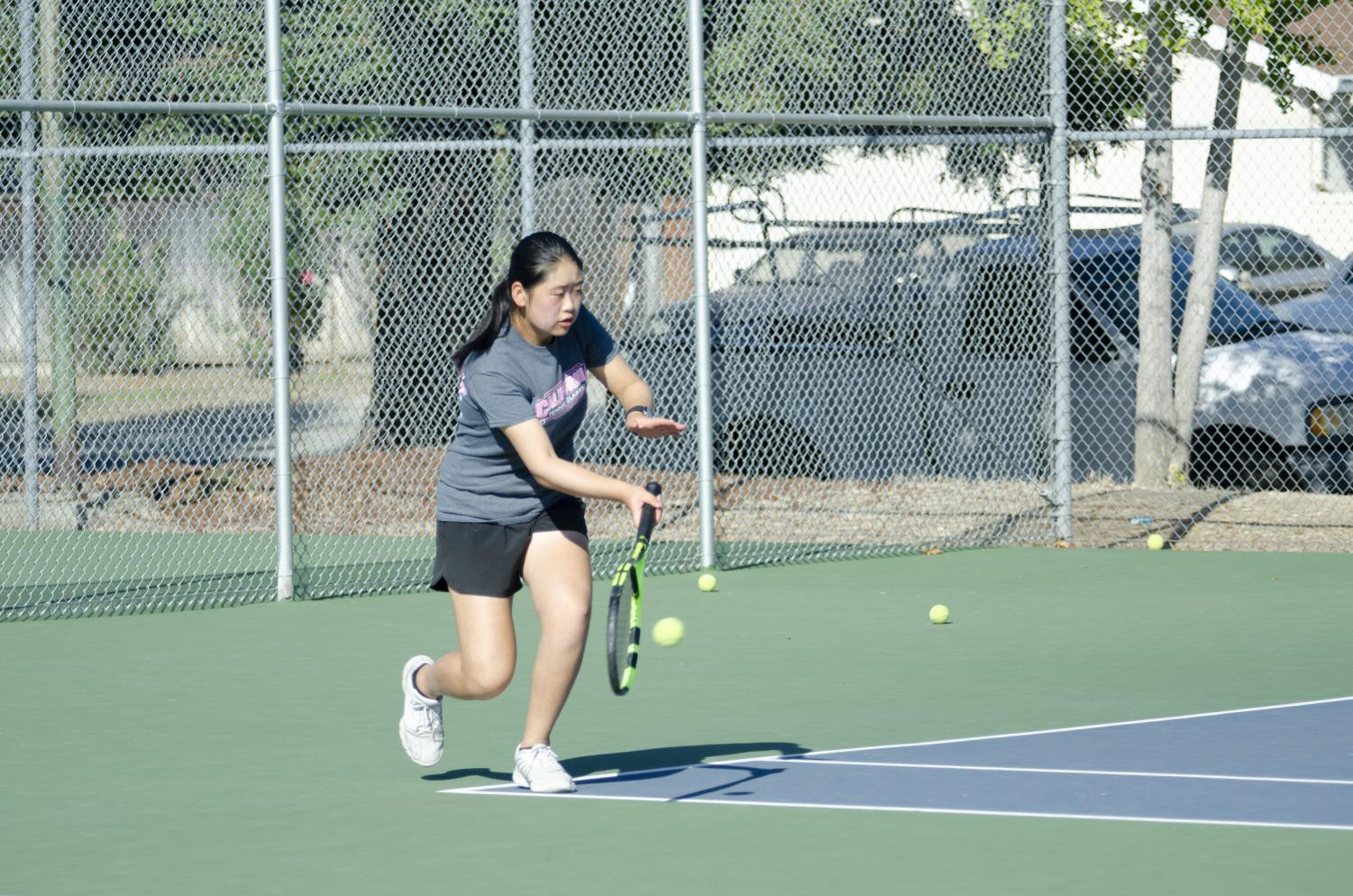 Tina+Zhong+%2810%29+hits+a+forehand+during+practice+at+the+Blackford+tennis+courts.+The+girls+will+play+their+next+match+against+Homestead+High+on+Sept.+23.+