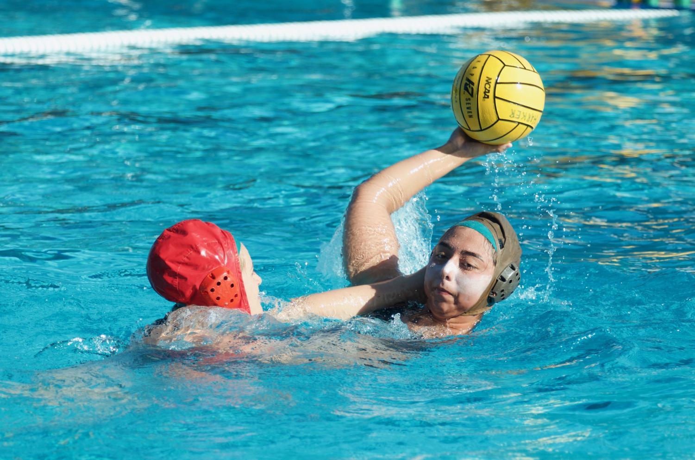 Cassandra Ruedy (12) passes during a varsity girls practice last week.