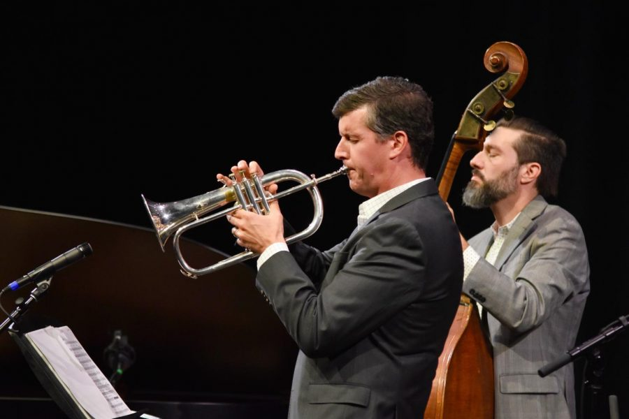 Upper school music teacher and Concert Series artistic director Dr. Dave Hart solos in one of Biali's songs on the trumpet. Dr. Hart, who knew Biali from a previous job, invited the award-winning jazz vocalist and pianist to kick off this year's Concert Series.