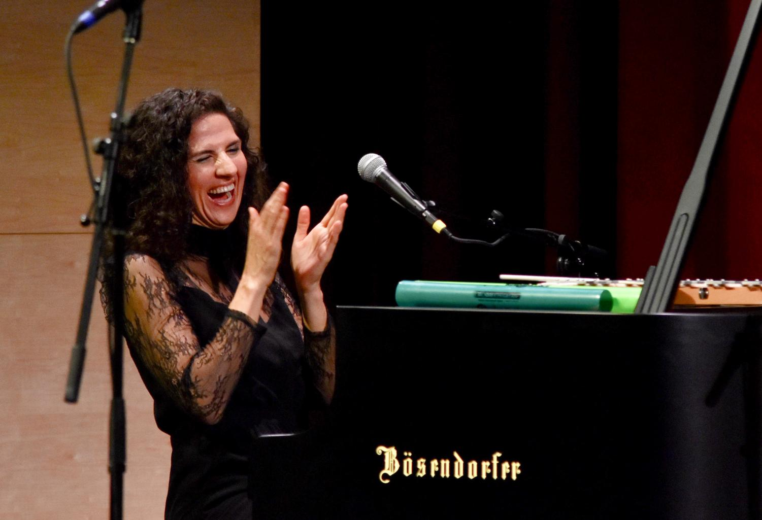 Juno Award winning jazz vocalist and pianist Laila Biali claps after performing one of her original works at the first Concert Series show last Friday night. In addition to her performance, Biali led workshops with jazz band, Downbeat and the upper school orchestra on Thursday and Friday.