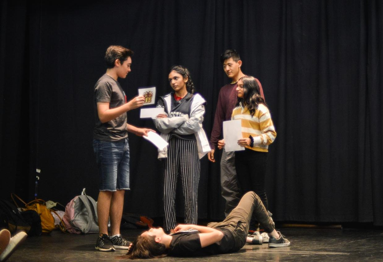 "Joel Morel (12), Esha Deokar ('19), Richard Wang ('19), Anjali Sheth (12), and Katrina Ipser ('19) participate in a theater workshop led by cast members of the Oregon Shakespeare Festival on last year's trip. This year, 23 students and three teachers from the upper school traveled to Ashland to visit the Oregon Shakespeare Festival and see plays like ""Macbeth,"" ""As You Like It,"" ""All's Well That Ends Well"" and ""La Comedia of Errors."""